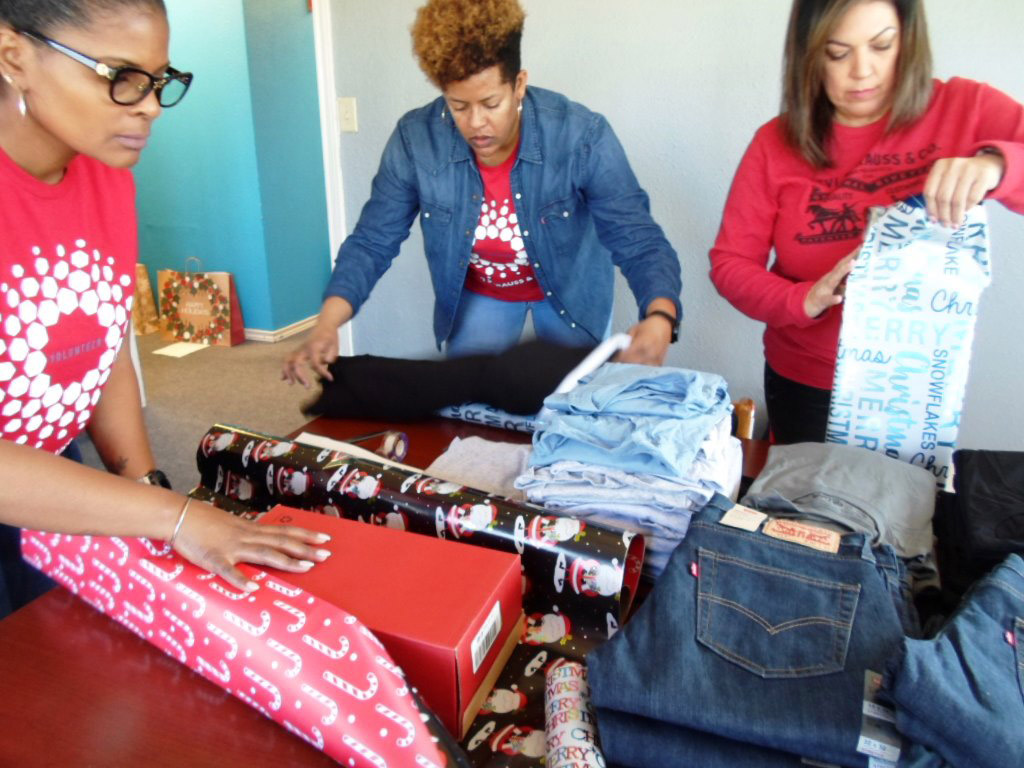 Levi Strauss volunteers wrap jeans, shirts and shoes for McFadden youth